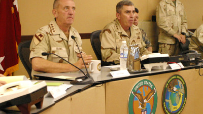 During a daily update United States Central Command Commanding General Tommy R. Franks, left, and his deputy Commander in Qatar, LT. General John Abigail meet with Frank's senior staff on March 25th to discuss with his combatant commanders the progress of Operation Iraqi Freedom at the Central Commands forward headquarters in Qatar. (Photo by Navy Petty Officer Gary P. Bonaccorso)